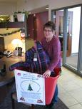 Amy Krzykowski of Members' Advantage Credit Union helped load up clothing items into collection bin before its pickup and delivery to Operation Bootstrap.